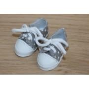Chaussures de sport grises à pois blancs
