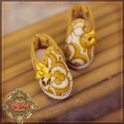Chaussures à motifs jaune doré  pour Yu Ping